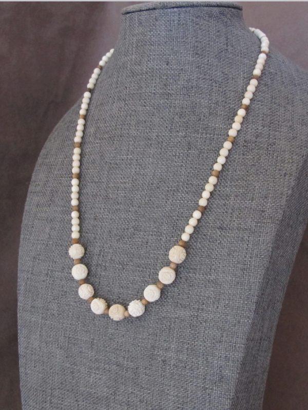 Carved rose beads string